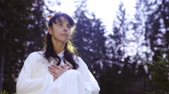 Woman meditate surrounded with trees 4K Stock Footage