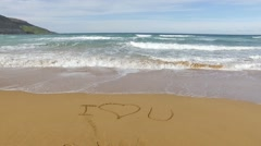 I Love you sign on sand - stock footage