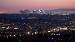 Time lapse long shot of Los Angeles, California city skyline lights at dusk Stock Footage