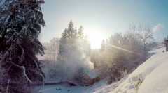 Wooden lodge in the winter wood Stock Footage