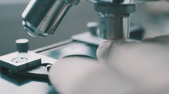 Scientist using a microscope in laboratory - stock footage