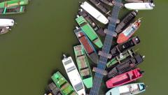 Aerial shot of beautiful river marina full of colorful boats. Stock Footage