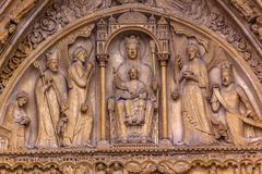 Biblical Statues Virgin Mary Baby Jesus Notre Dame Cathedral Paris France - stock photo