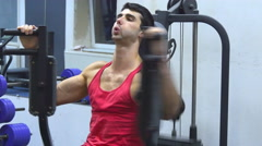 Man training on training apparatus Stock Footage