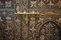 Old artfully decorated door detail historic centre Marrakech Morocco Africa - stock photo