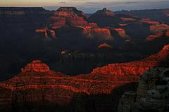 Rock formations in the evening light view from South Rim Trail Grand Canyon - stock photo