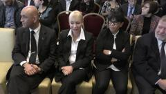 Senior public servants, judges and lawyers, attend the swearing in ceremony Stock Footage