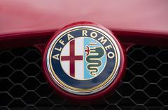 Close-up view of the logo on Alfa Romeo - stock photo