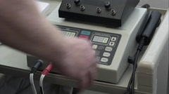 Therapist setting electrode equipment. - stock footage