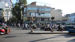 People diving car and riding motorcycle at traffic road near Ben Thanh Market Stock Footage