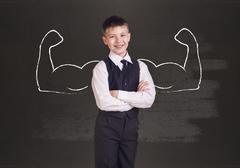 Stock Photo of Little boy with drawn powerful hands