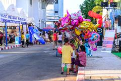 Stock Photo of SAMUT SONGKHRAM , THAILAND - 2015 December 26: Unidentified woman hawker sell