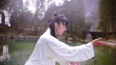 Kung Fu person outdoors training dragon forms 4K Stock Footage