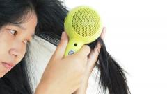 Haircare. Beautiful long haired woman drying hair, white background. Stock Footage