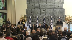 A robed Judge swears in, signs and shakes hands with President Rivlin Stock Footage