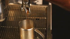 Pouring coffee in slow motion Stock Footage