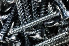 Construction metal screws Stock Photos