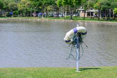 Life buoy for safety at urban pond. - stock photo