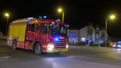Fire truck, siren on, passing carfour at night - audio include Stock Footage