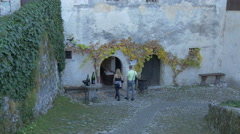 Couple visiting the Bled Castle, Bled Stock Footage