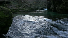 The foamy water of Radovna river flowing through rocks in Bled Stock Footage