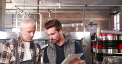 Smiling brewery workers talking together Stock Footage