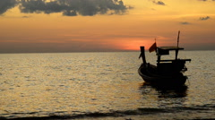 Beautiful sunset and boat at the beach Stock Footage