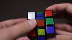 A person desperately trying to solve the Rubik cube,but it´s not an easy task - stock footage