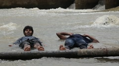 Indian buddies lying in river together - stock footage