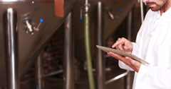 Smiling brewery worker using tablet Stock Footage
