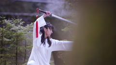 Kung fu martial art pose with sword in nature 4K Stock Footage