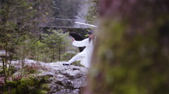 Behind the tree slide of woman hold long sword on big rock 4K Stock Footage