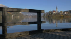 Church of the Assumption of Maria seen from a wooden dock, Bled Stock Footage