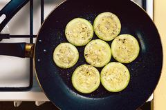 Fried zucchini slices prepared on a pan - stock photo