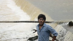 Stock Video Footage of Indian man standing close to river