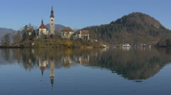 Reflection of Church of the Assumption of Maria on the lake, Bled Stock Footage