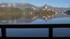 Church of the Assumption of Maria seen from a dock at Lake Bled, Bled Stock Footage