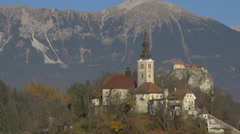 View of mounains, Bled castle and Church of the Assumption in Bled Stock Footage