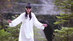 Person make dragon form Nu Dang Gong outside in nature 4K Stock Footage