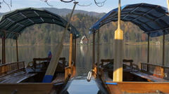 View of two moored pletnas on the lake shore in Bled Stock Footage