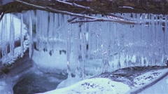 Icicles over the river in slow motion in winter Stock Footage