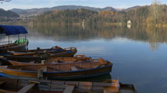 Amazing view of moored boats on the shore of Bled lake in Bled Stock Footage
