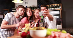 Group of smiling friends taking selfie together Stock Footage