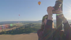 Woman films hot air balloon - stock footage