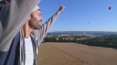 Man raises his arms in celebration Stock Footage