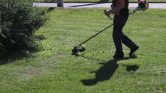 Lawnmower during the workday - stock footage