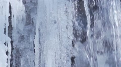 Water flowing in slow motion on frozen icicles Stock Footage