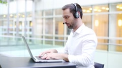 Business man with headset Stock Footage