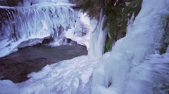 Waterfall running in slow motion under the ice Stock Footage
