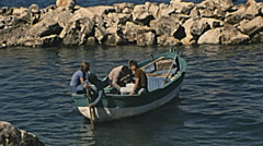 Apulia 1974: young fishermen working - stock footage